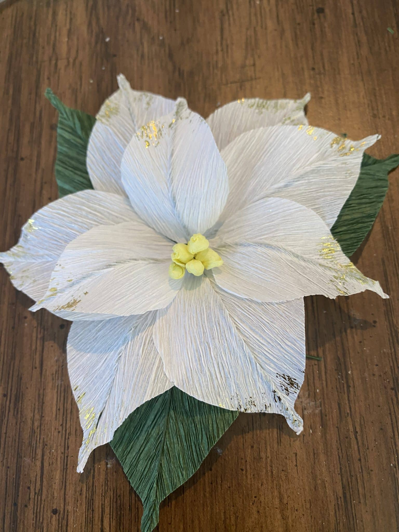crepe paper poinsettia for gift wrap